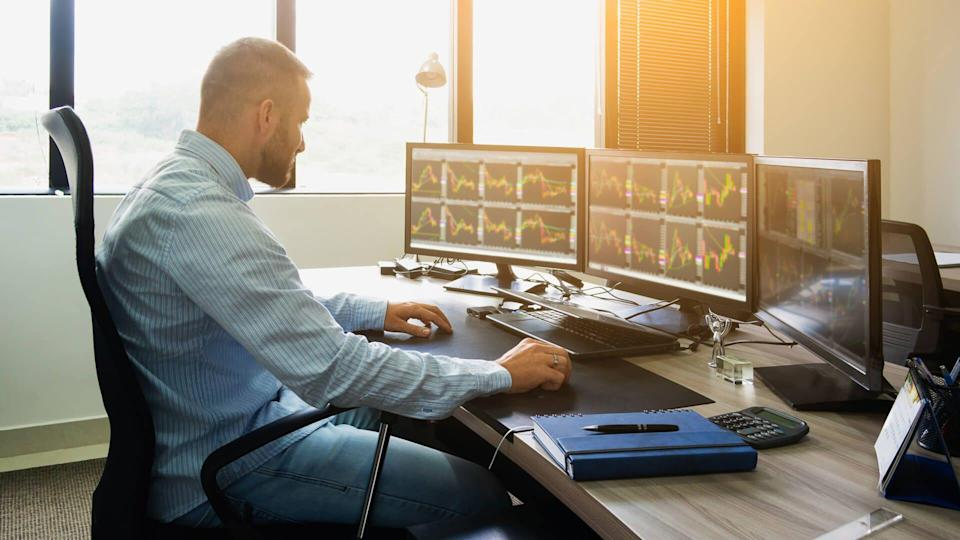 young man day trading stocks