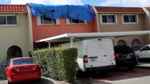 This is the sight no Florida homeowner ever wants to see. A tarp covers a leaky roof in Hialeah on Thursday, October 6, 2020.
